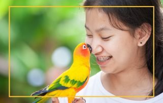 Teenage girl with pet parrot